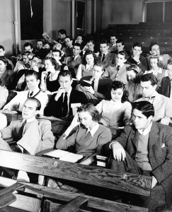"This photo was titles ""Boring Lecture, 1940s"" https://www.flickr.com/photos/dukeyearlook/2076633334/in/photostream/"